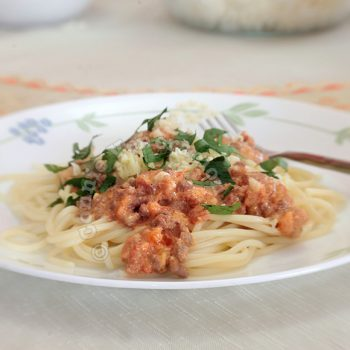 Mighty meaty pasta with tomato cream sauce