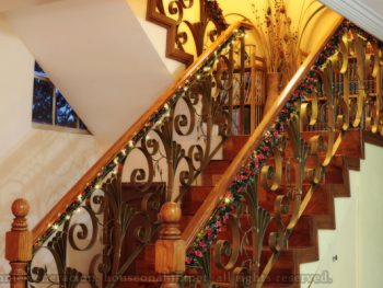 Christmas decorating idea: wound yards and yards of garland and fairy lights on the stair banister