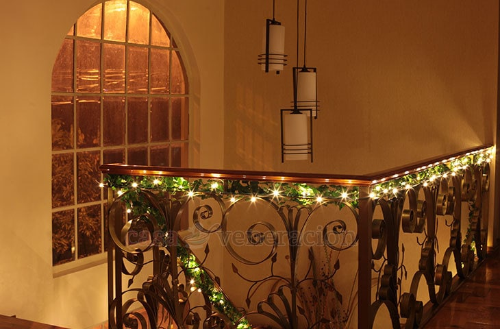 Christmas decorating idea: wind yards and yards of garland and fairy lights on the stair banister