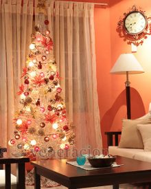 A white Christmas tree with red and gold decor