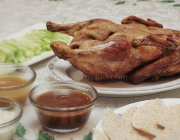 Roast duck with tortilla wraps