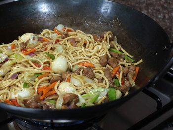 A dish of Chinese origin that has become very much a part of Filipino cuisine, pancit canton may refer to lo mein or chow mein, depending on who you're talking to.