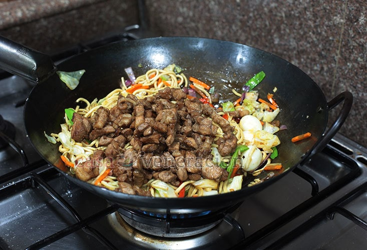 Pancit Canton (Filipino-style Chow Mein) Recipe, Step 5: Toss in the cooked pork