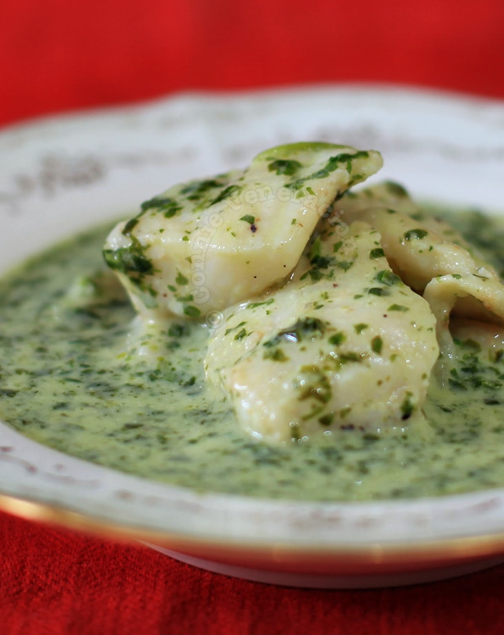 Fish fillets with creamy spinach sauce