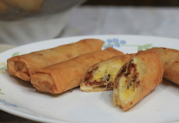 Turon with bacon and cheese. Salty, crisp bacon bits contrasting vividly with the sweet and mushy overripe bananas. Then, the surprising touch of gooey cheese. We drooled.