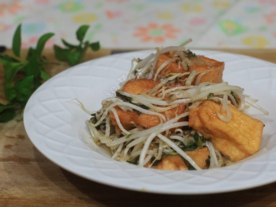 Sweet and sour tofu with bean sprouts and fresh herbs