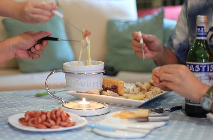 A Fondue Party: With a cheese fondue on the table, have fun dunking bread and meat in the gooey cheese