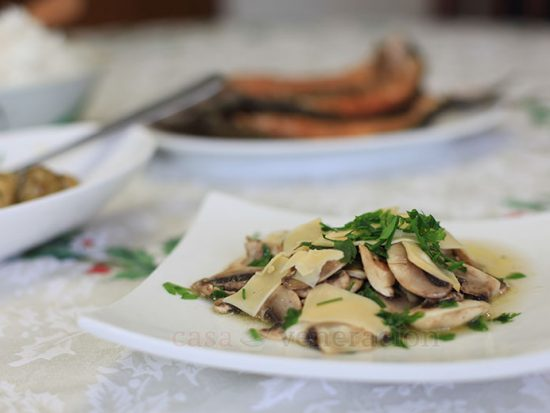 In the original recipe, the fresh button mushrooms were simply sliced — very raw — and tossed with the parsley and dressing. But when using grocery-bought mushrooms that have been transported from place to place, probably chilled and re-chilled, well, it seemed more prudent to blanch them first.