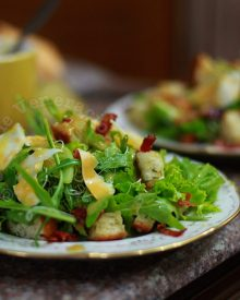 Arugula and alfalfa sprouts salad with honey, mustard and ginger dressing