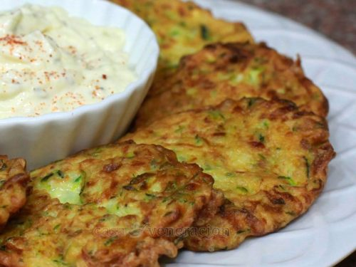 Zucchini Fritters: Shredded zucchini is mixed with flour and egg and pan fried. Nice crunch outside, nice specks of green peeping through the golden brown crust… and, the best part? Very easy to prepare.