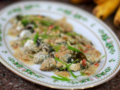 Ginataang isda: salay ginto wrapped in pechay leaves and p[ressure cooked