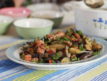The trick to making this sweet-sour and spicy pork with flash-fried eggplants is to cook the stir fried pork and eggplants separately. Add the flash-fried eggplants to the pork at the end of cooking time and simply toss to blend.