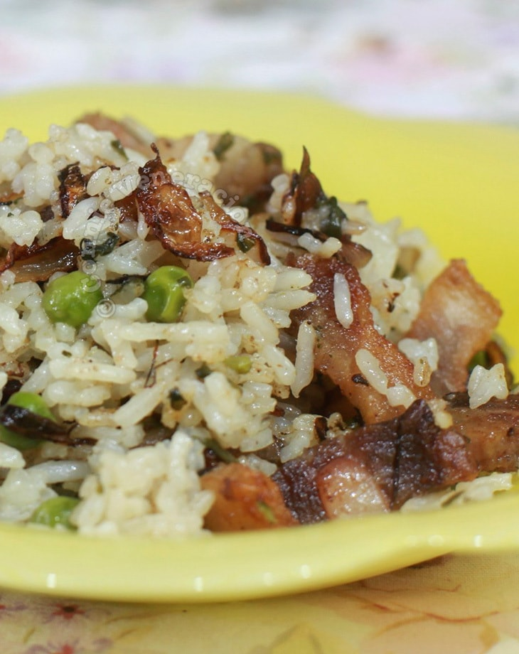 Herbed Rice With Crispy Pork Belly and Caramelized Onions