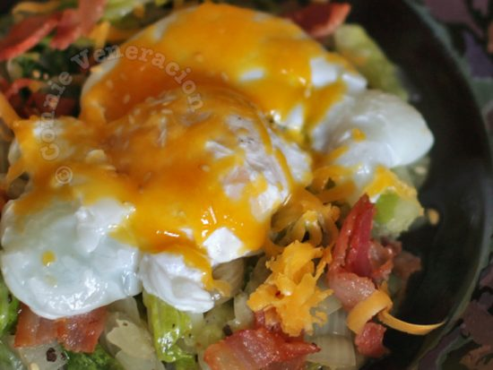 Warm lettuce and bacon salad with poached egg