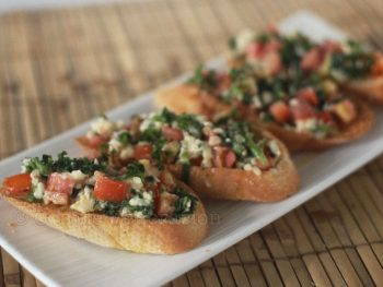 Bruschetta with spinach, tomato and cheese