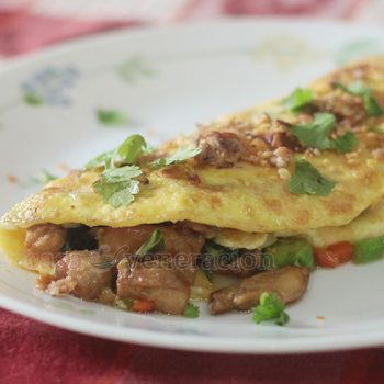 Cooked with leftover meat and vegetables chosen for the crisp texture, this kailan (Chinese broccoli) and bok choy tips omelet makes a lovely hearty breakfast or a light lunch.