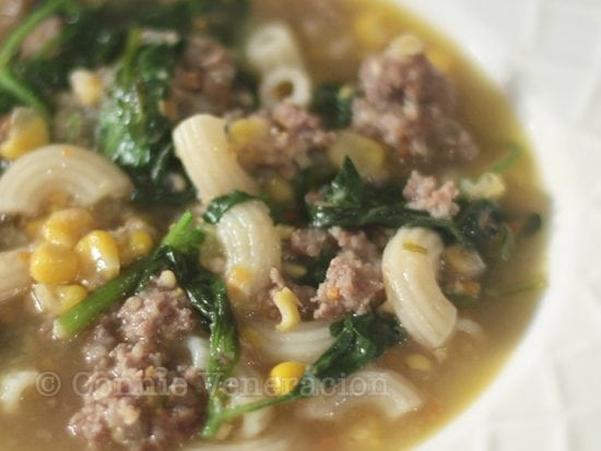 Macaroni soup with meatballs, corn and spinach