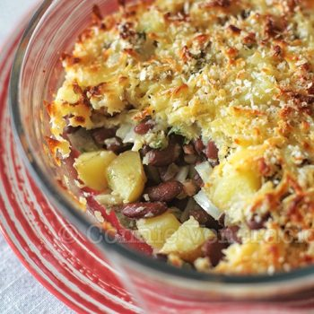 Cheese-topped baked beans and potatoes