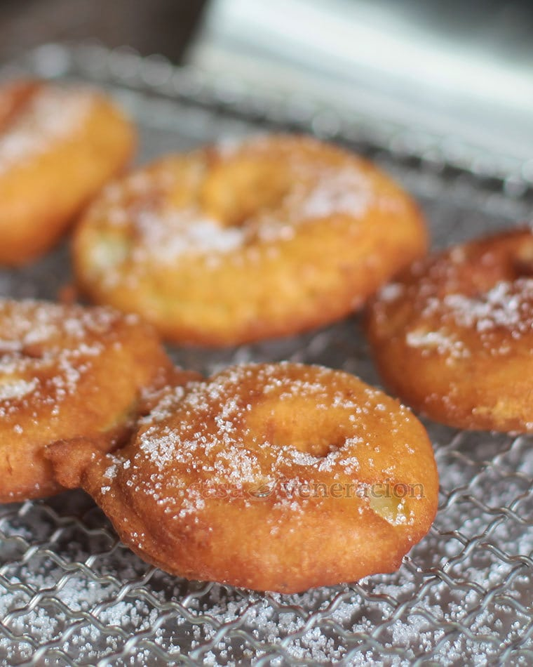 To make apple fritters, slice and core an apple, toss in flour, dip in pancake batter and fry. Sprinkle with cinnamon sugar for the ultimate experience!
