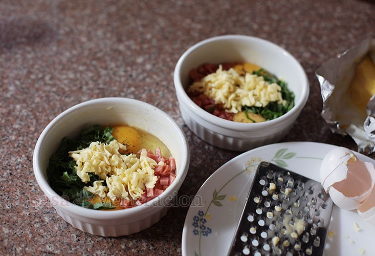You can prepare baked eggs with ham, greens and cheese for several people all at once. No need to fry or poach eggs one by one. Just crack them into single-serve ramekins, add whatever you'd like, season and pop into a preheated oven.
