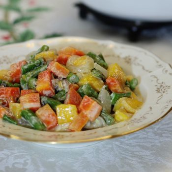 Mixed vegetables and semi-ripe mangoes in coconut milk
