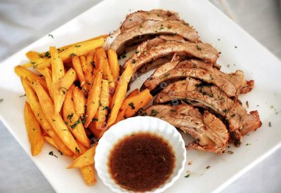 Mango and honey-glazed baby back ribs with sweet potato fries