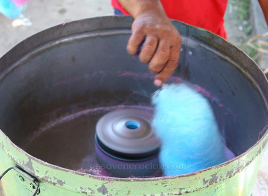 What is cotton candy made of and how is it produced?
