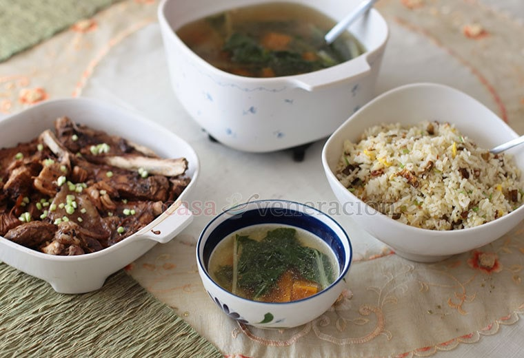 A typical meal for a family of three omnivores and one vegetarian: pork ribs adobo, vegetable dish and egg, chili and eggplant fried rice.