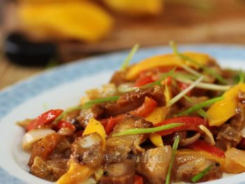 Grilled pork, pepper and mango stir fry with peanut sauce