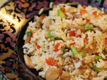 Pilaf can be plain rice boiled in broth. While plain pilaf is delicious, I added leeks, pepper, asparagus and mushrooms for more color and flavor.