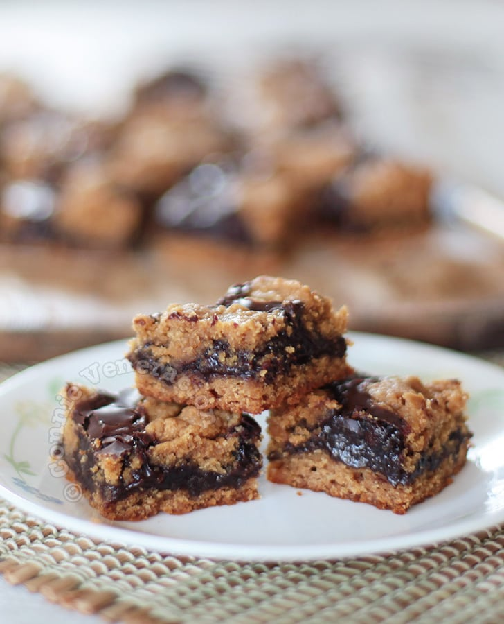 Peanut butter cookie squares with chocolate and dulce de leche filling