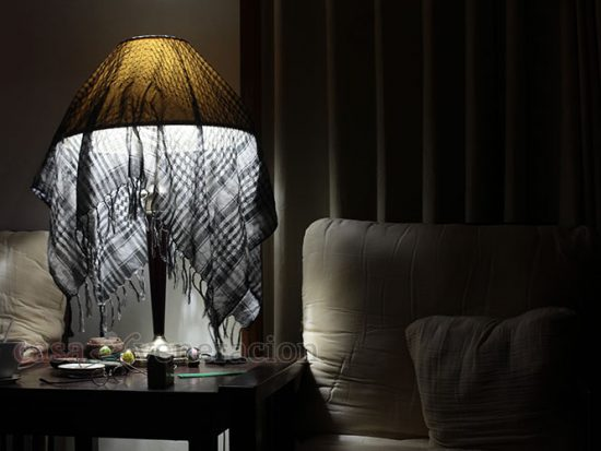 How to dim the light with style? Throw a semi-sheer shawl over it.