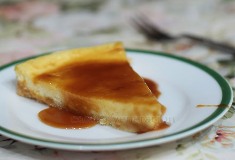 A cheese cake baked in a tart pan and with only half the usual amount of cheese and cream mixture. No Graham cracker crust for this dessert. Instead, the crust is made with flour, butter, sugar and chopped nuts. Amazing texture.