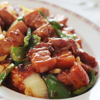 Pork belly is braised with Chinese fermented black beans, Korean chili paste, ginger and garlic until tender. Vegetables and fried tofu are tossed in, and honey is added to round up the flavors. Pork and tofu with black beans and chili sauce is an easy one-pan dish to enjoy with hot rice.