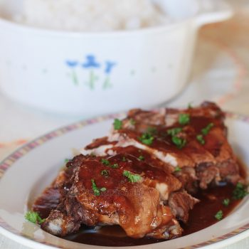 For this pork ribs with chili sauce, a rack of ribs was browned and braised in spices, broth and soy sauce. The sauce was thickened and pour over the ribs.