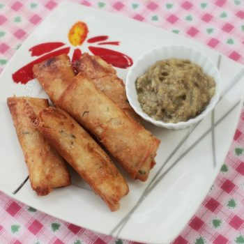 Rice-stuffed fried spring rolls with eggplant caviar dip