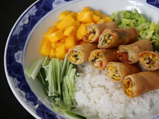 Tinapa (smoked fish), salted eggs and tomato spring rolls rice bowl