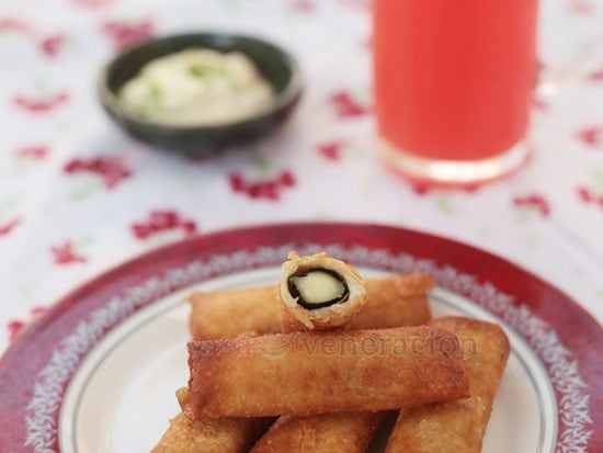 Nori-wrapped cheese strips are wrapped with spring roll wrappers, fried then served with wasabi mayo as a dipping sauce