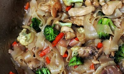 Stir fried hofan with pork, chicken and vegetables
