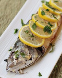 Whole fish poached in olive oil with lemon-butter sauce