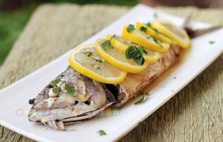 Whole fish poached in olive oil with lemon-butter sauce | casaveneracion.com