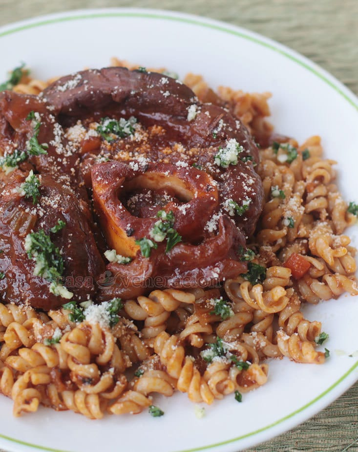 The most visually exciting way to serve osso buco pasta dish is to top each bowl of noodles with a whole cross cut of beef shank with the bone marrow intact.