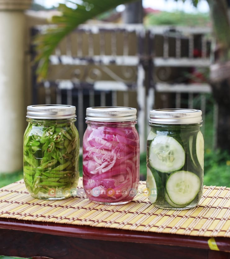 Homemade pickled red onions, chilies and cucumbers