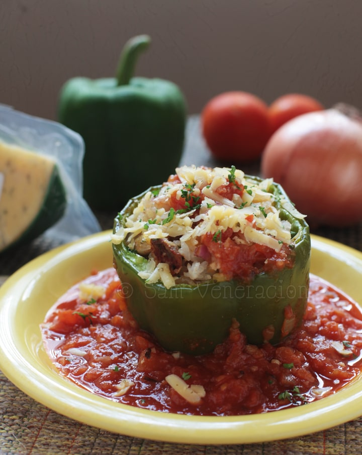 Vegetarian stuffed bell peppers with fresh tomato sauce
