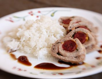 Grilled pork tenderloin stuffed with sausages and cheese