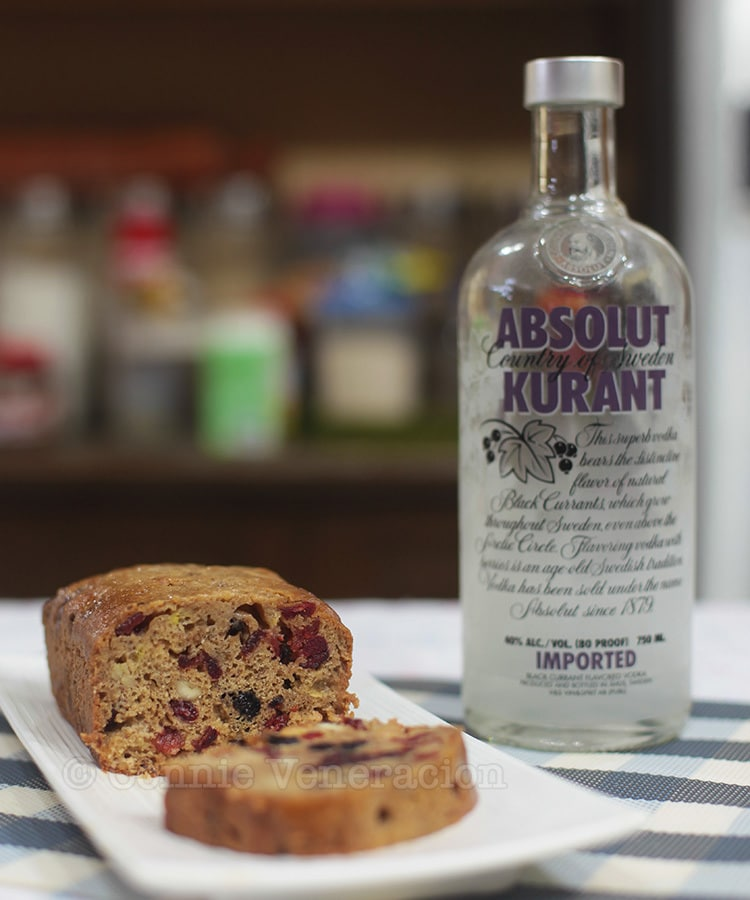 Fruit cake with blueberries, cranberries and cashew nuts doused with black currant vodka