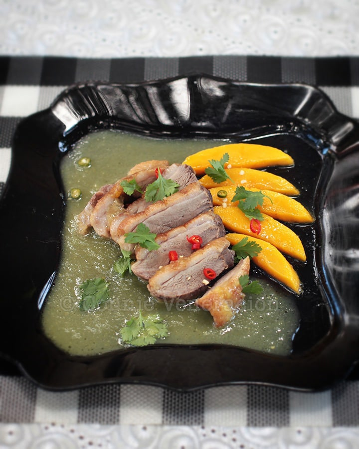 Duck braised in green mango sauce