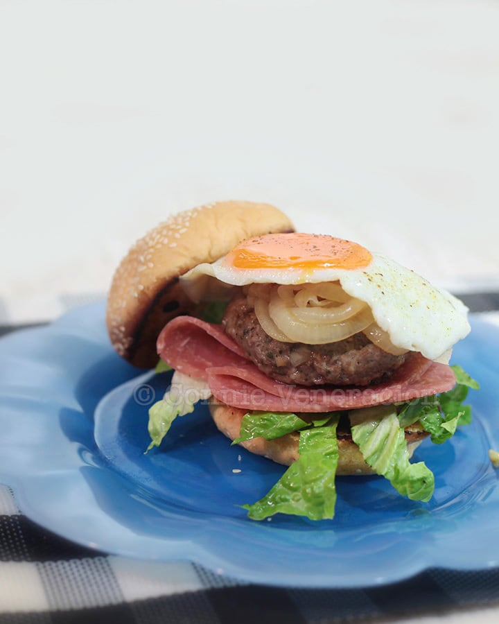 Burger with ham, caramelized onion and fried egg
