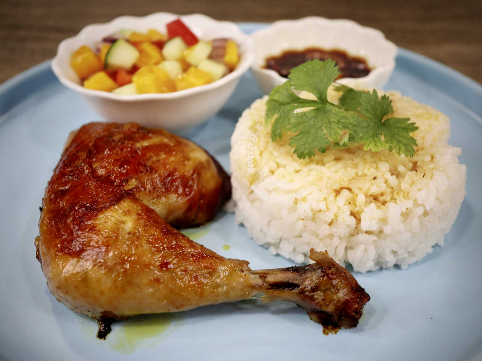 Chicken inasal with rice, salad and dipping sauce