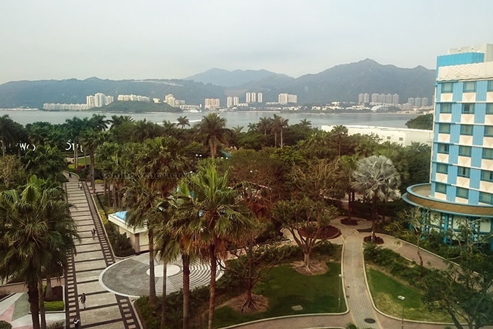 View from our Disney Hollywood Hotel: the hotel's garden, Discovery Bay, Discovery Beach and the hills rising majestically beyond them